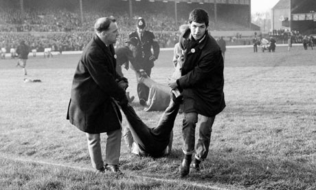 An anti-apartheid demonstrator is dragged off the Twickenham pitch, 1969
